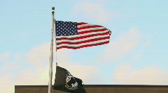 USA and POW Flag in Wind Stock Footage