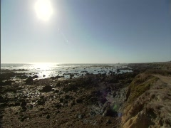 Ocean Rocks Sunflare 2 Stock Footage