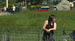 Woman Talks to Passerby on Bridge Stock Footage