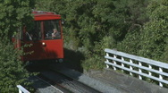 Stock Video Footage of cablecar acsends steep hill