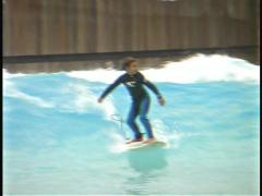Boy surfing Stock Footage