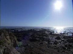 Ocean Rocks Sunflare Stock Footage