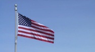 Stock Video Footage of American (USA) Flag on Blue Sky - Set Left