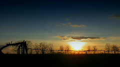 Time lapse Sunset over field. Stock Footage