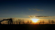 Stock Video Footage of time lapse Sunset over field.