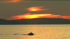 Small Boat in Sunset Stock Footage
