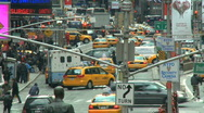 Traffic and People cross a busy times square. Stock Footage