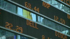 A stock ticker scrolls near times square Stock Footage