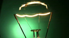 Electric light bulb switching on and off. Stock Footage