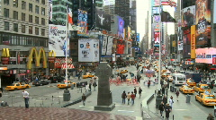 Pan of Traffic and People at times square Stock Footage
