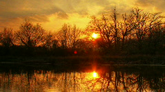Sunset over water hdr time lapse - stock footage