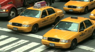 Stock Video Footage of Taxi Traffic file through an intersection
