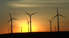windmills & sunset - stock footage