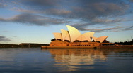 Stock Video Footage of Sydney Opera House at sunset with calm water