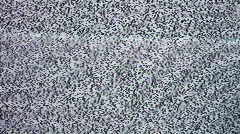 TV screen with white noise or static snow. - stock footage