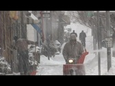 Stock Video Footage of Snow blowing on downtown sidewalk during snowstorm