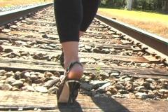 Beautiful Brunette Walking on a Railroad Track (1a) Stock Footage