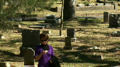 Morning woman at grave Stock Footage