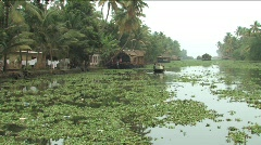 Houseboat on the backwater of Alleppey India Stock Footage