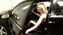 Woman Gets Out of Car in Parking Lot - stock footage