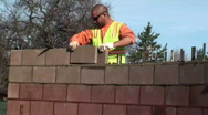 Bricklayer, mason, construction worker Stock Footage
