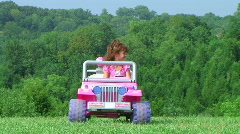 Girl Driving Toy Jeep Stock Footage
