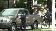 Bicycle police ticketing car Stock Footage