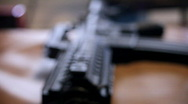 Stock Video Footage of Gun Rack FOcus assualt rifle