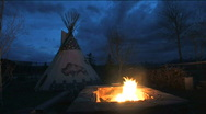 Stock Video Footage of Tipi with Fire at Dusk
