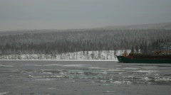 A ship moves through ice floes on a river  Stock Footage