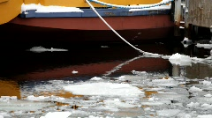 Ice floes in a harbour a bumping against a ship Stock Footage