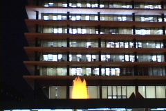 A golden fountain sparkles in front of a high-rise office building at night. Stock Footage