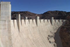 Mountains peak over the majestic Hoover Dam. Stock Footage