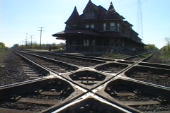 An old Victorian railway station stands amid tracks in Flint, Michigan. Stock Footage