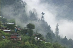 Mist rises from a mountainside in the Himalayas. Stock Footage