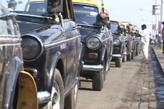 Taxis line up on a Mumbai city street. Stock Footage