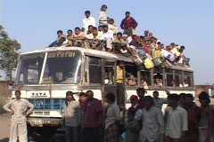 Passengers sit atop a crowded bus. Stock Footage