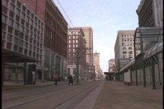 A trolley rolls down a city street in Buffalo, New  York. Stock Footage