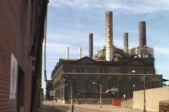 Smoke stacks top an abandoned warehouse. Stock Footage