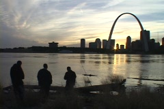 Fishermen gaze across the Mississippi river at the St. Louis arch. Stock Footage