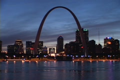Stock Video Footage of The Arch towers over the St. Louis skyline.