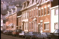 Brownstone apartments line a street. Stock Footage