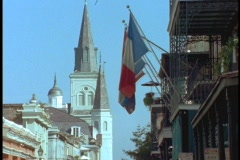 A church and French flags rise above the French Quarter. Stock Footage