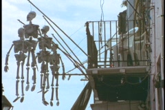 Skeletons hang from the balcony of a building in the French Quarter of New Stock Footage