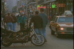 Tourist wander the French Quarter of New Orleans. Stock Footage