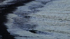 Ice covering the sand of a beach on a cold winter day Stock Footage