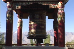 A woman spins a giant prayer wheel. Stock Footage