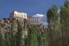 A monastery adorns a cliff top in Ladakh. Stock Footage