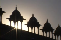 The sun's rays shine past a row of Mogul domes. Stock Footage