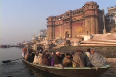 Hindu pilgrims sing and clap in a boat. - stock footage